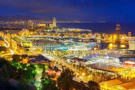 barcelona spain: Aerial view over Port Vell marina, Passeig de Colom, Barceloneta and Rambla de Mar at night in Barcelona, Catalonia, Spain