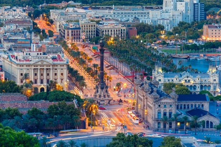 Aerial view over square Portal de la pau, and Port Vell marina and Columbus Monument at evening in Barcelona, Catalonia, Spain