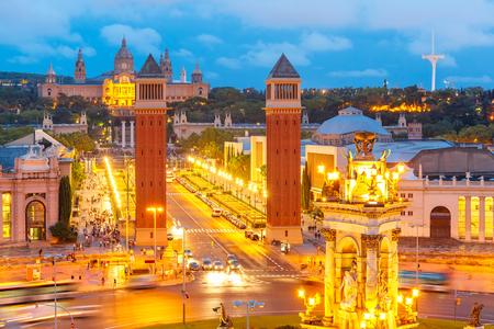 Aerial view of venetian columns, National Art Museum and Placa Espanya in Barcelona at night, Catalonia, Spain