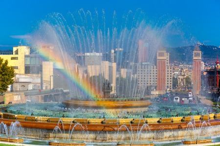 montjuic: Rainbow over the Magic Fountain of Montjuic at Placa Espanya in Barcelona at sunny summer day, Catalonia, Spain