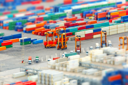 View of the cargo port and container terminal of Barcelona with the Montjuic hill, Barcelona, Catalonia, Spain. Shallow depth of field.