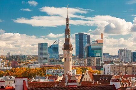 europe eastern: Aerial cityscape with old town hall spire and modern office buildings skyscrapers in the background in Tallinn in the day, Estonia