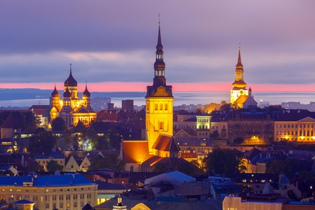 saint nicholas: Aerial cityscape with Medieval Old Town illuminated in evening twilight with Saint Nicholas Church,  Cathedral Church of Saint Mary and Alexander Nevsky Cathedral in Tallinn, Estonia Stock Photo