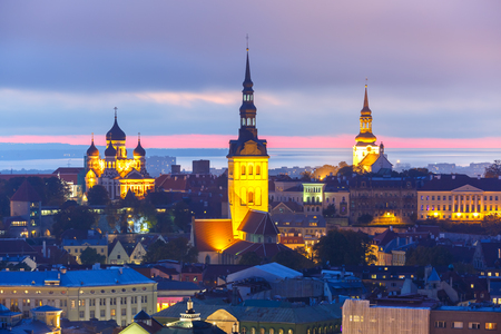 'saint nicholas': Aerial cityscape with Medieval Old Town illuminated in evening twilight with Saint Nicholas Church,  Cathedral Church of Saint Mary and Alexander Nevsky Cathedral in Tallinn, Estonia Stock Photo