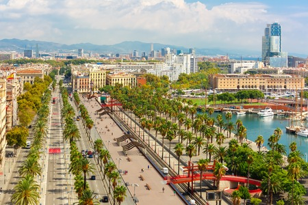 Aerial view over Passeig de Colom or Columbus avenue,  La Barceloneta and Port Vell marina  from Christopher Columbus monument  in Barcelona, Catalonia, Spain