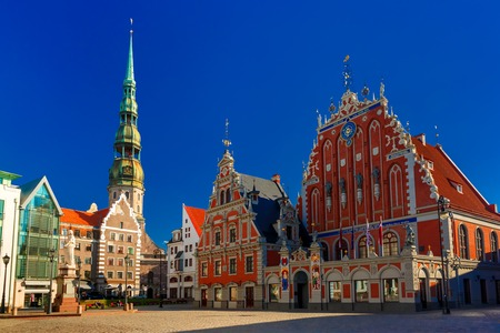 europe travel: City Hall Square with House of the Blackheads, Saint Roland Statue and Saint Peter church in Old Town of Riga, Latvia Stock Photo