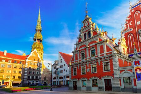 City Hall Square with House of the Blackheads and Saint Peter church in Old Town of Riga in the evening, Latvia