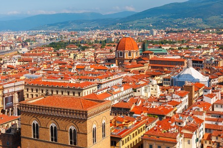 View of city rooftops and Medici Chapel at morning from Palazzo Vecchio in Florence, Tuscany, Italy