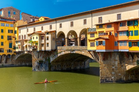 river arno: Rower canoe before the bridge Ponte Vecchio across River Arno in the sunny summer day, Florence, Tuscany, Italy