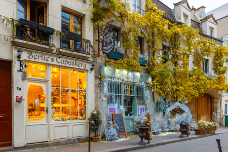 europe travel: Paris, France - December 19, 2015: Typical Parisian cafes decorated for Christmas in the heart of Paris. Christmas is one of the main Catholic holidays, which is celebrated on a large scale throughout Europe. Editorial