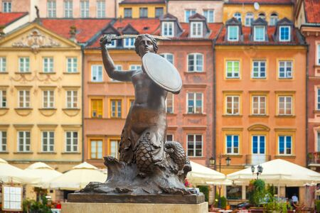 mermaid: Statue of Syrenka, Mermaid of Warsaw, symbol of the city of Warsaw, at the Old Town Market Square, Poland