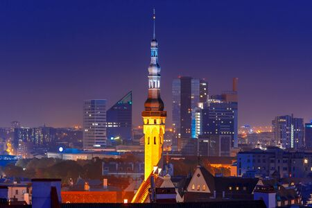 old town hall: Night aerial cityscape with old town hall spire and modern office buildings skyscrapers in the background in Tallinn at blue hour, Estonia