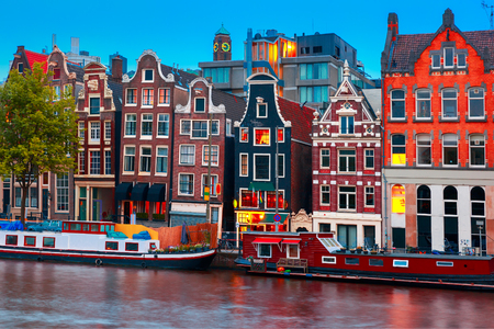 Night city view of Amsterdam canal, typical dutch houses and boats, Holland, Netherlands. Stock fotó