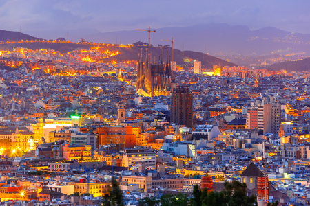 landscape: Aerial view Barcelona illuminated from the Montjuic hill at night, Catalonia, Spain.