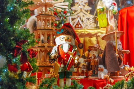 Santa Claus, Christmas tree and toys at a Christmas souvenir  market shop, decorated and illuminated in Bruges, Belgium