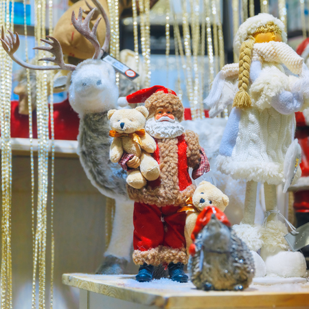 'snow maiden': Santa Claus, Christmas reindeer, bears and Snow Maiden at a Christmas souvenir  market shop, decorated and illuminated in Bruges, Belgium Stock Photo