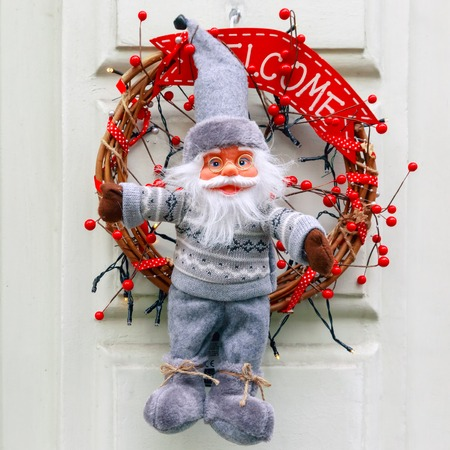 advent wreath: Santa Claus and Advent wreath on the doors of the house in Bruges, Belgium