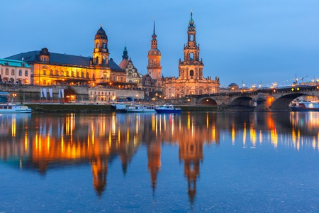 old bridge: Dresden Cathedral of the Holy Trinity aka Hofkirche Kathedrale Sanctissima Trinitatis, Bruehls Terrace aka The Balcony of Europe and Augustus Bridge with reflections in the river Elbe at night in Dresden, Saxony, Germany