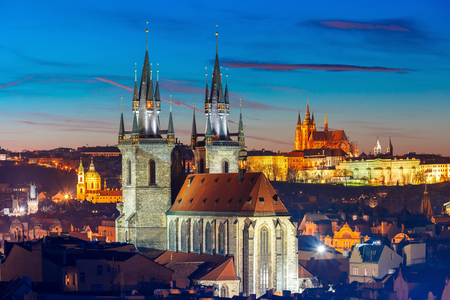 tyn: Aerial view over Church of Our Lady before Tyn, Old Town and Prague Castle at night in Prague, Czech Republic