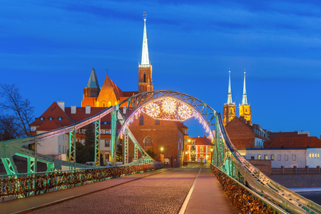st john: Tumski Bridge and Island with Cathedral of St. John and church of the Holy Cross and St. Bartholomew at night in Wroclaw, Poland Stock Photo