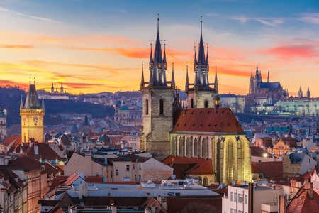 Aerial view over Church of Our Lady before Tyn, Old Town and Prague Castle at sunset in Prague, Czech Republic