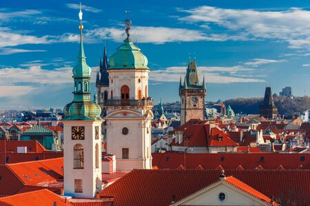 unesco in czech republic: Aerial view over Old Town in Prague with domes of churches, Bell tower of the Old Town Hall, Powder Tower, Czech Republic