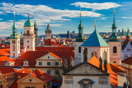 city view: Aerial view over Old Town in Prague with domes of churches, Bell tower of the Old Town Hall, Powder Tower, Czech Republic