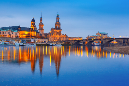 old bridge: Landscape view of Augustus Bridge with reflections in the river Elbe at night in Dresden, Saxony, Germany