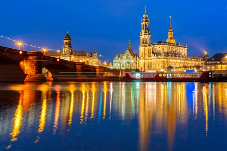 augustus: Dresden Cathedral of the Holy Trinity aka Hofkirche Kathedrale Sanctissima Trinitatis and Augustus Bridge with reflections in the river Elbe at night in Dresden, Saxony, Germany Stock Photo