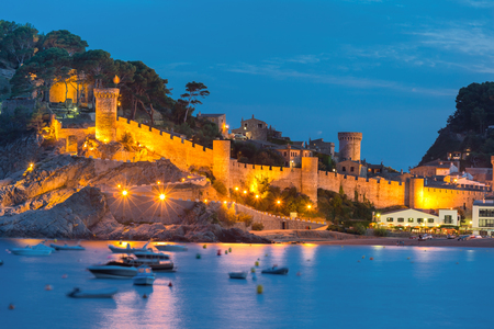 costa brava: Night view of fortress and fishing boats in Tossa de Mar on Costa Brava, Catalunya, Spain