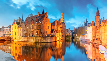 belfort: Scenic cityscape with a medieval fairytale town and tower Belfort from the quay Rosary, Rozenhoedkaai, at sunset in Bruges, Belgium