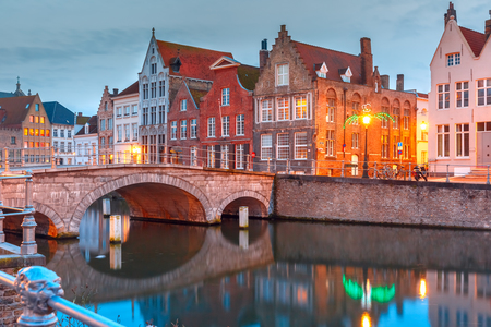 scenic: Scenic city view of Bruges canal with medieval colored houses, bridge and reflections, Belgium