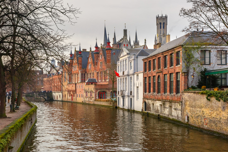 belfort: Scenic winter cityscape with a medieval tower Belfort and the Green canal, Groenerei, in Bruges, Belgium
