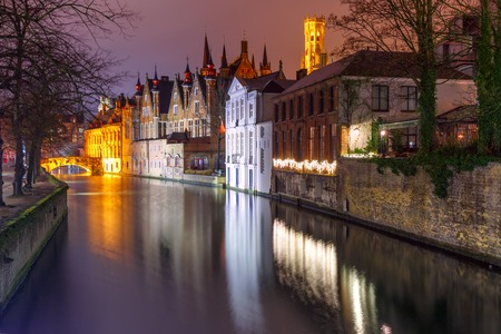 belfort: Scenic night cityscape with a medieval tower Belfort and the Green canal, Groenerei, in Bruges, Belgium Stock Photo