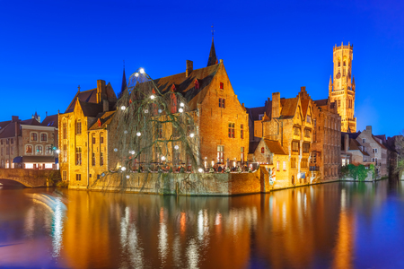 różaniec: Scenic panorama with medieval fairytale town and tower Belfort from the quay Rosary, Rozenhoedkaai, in the evening, Bruges, Belgium