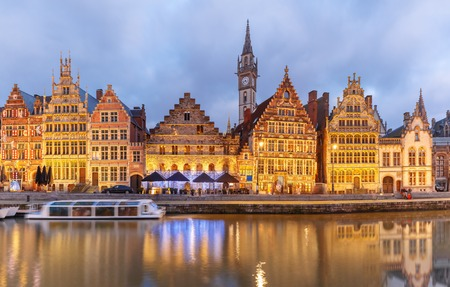 gent: Picturesque medieval building on the quay Graslei in Leie river at Ghent town at evening, Belgium Stock Photo