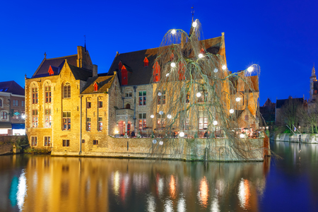 belfort: Scenic panorama with medieval fairytale town and tower Belfort from the quay Rosary, Rozenhoedkaai, in the evening, Bruges, Belgium
