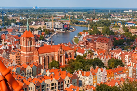 gdansk: Aerial view of Old Town with St. John church and Motlawa River, harbor, ship yard and Baltic Sea in the summer morning, Gdansk, Poland