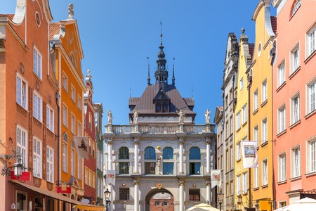 east gate: Beautiful historic houses and Golden Gate on Long Lane in Gdansk Old Town in the sunny morning, Poland