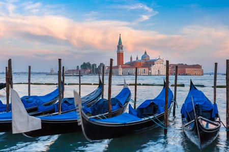 saint mark square: Gondolas moored by Saint Mark square with San Giorgio di Maggiore church in the background in the evening, Venice, Italia