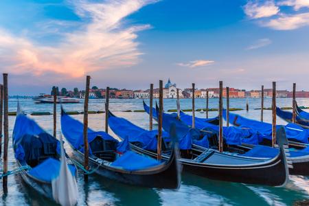 saint mark square: Gondolas moored by Saint Mark square in the evening, Venice lagoon, Italia