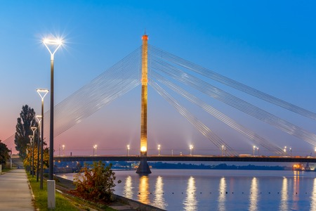 gorky: Cable-stayed bridge and embankment of the River Daugava during twilight blue hour, Riga, Latvia