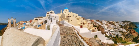 ia: Picturesque panorama, Old Town of Oia or Ia on the island Santorini, white houses and church with blue domes, Santorini, Greece