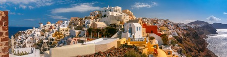 ia: Picturesque panorama, Old Town of Oia or Ia on the island Santorini, white houses, windmilles and church with blue domes, Greece