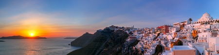 sea of houses: Picturesque panorama of Fira, main town of the island Santorini, sea, white houses and church at sunset, Greece
