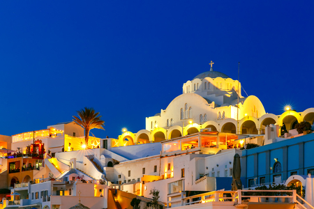 thera: Orthodox Metropolitan Cathedral of Fira, modern capital of the Greek Aegean island, Santorini, during twilight blue hour, Greece