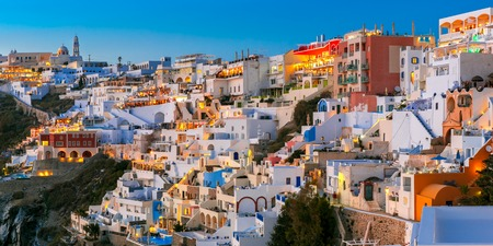 thera: Fira, modern capital of the Greek Aegean island, Santorini, with Orthodox Metropolitan Cathedral, during twilight blue hour, Greece Stock Photo