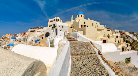 ia: Picturesque panorama, Old Town of Oia or Ia on the island Santorini, white houses and church with blue domes, Greece
