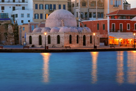 morning blue hour: Picturesque view of Venetian quay of Chania with Kucuk Hasan Pasha Mosque during mornng blue hour, Crete, Greece
