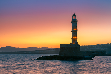 morning blue hour: Lighthouse in old harbour of Chania at sunrise, Crete, Greece